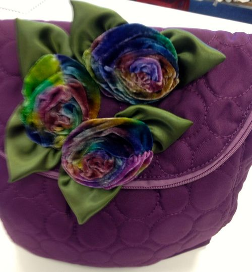 Plum purse with roses